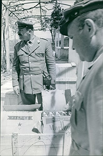 vintage-photo-of-two-military-soldiers-inspecting-a-box-of-marlboro-cigarettes