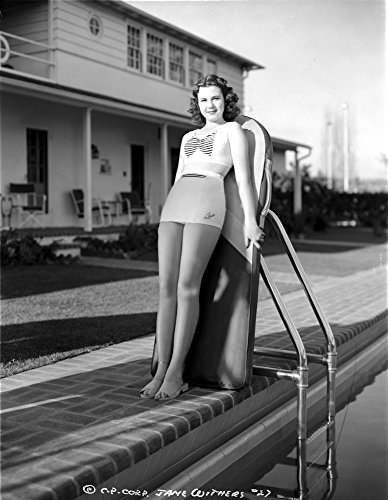 The Poster Corp Jane Withers Posed in White Sleeveless Bodice and Mini Skirt with Legs Closed and Feet Together Photo Print (60,96 x 76,20 cm) -