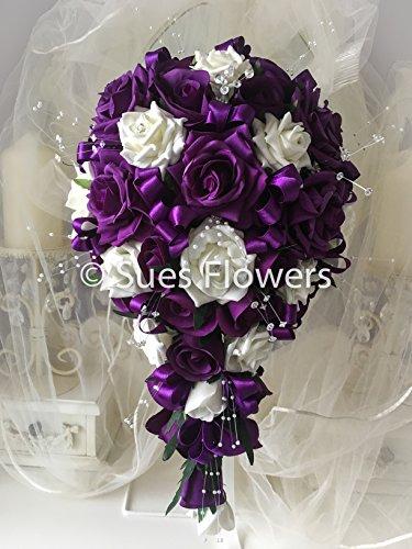 wedding-flowers-brides-teardrop-bouquet-in-cadburys-purple-and-ivory