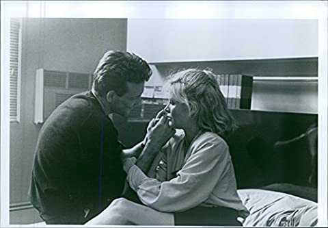 "Vintage photo of Mickey Rourke and Kim Basinger in a scene from a 1986 American erotic romantic drama film, ""9½ Weeks""."
