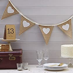 Our rustic hessian vintage bunting has white printed hearts and lace ribbon stitched at the top of each triangular flag. Ideal for using at a wedding or party above your candy bar / buffet! The bunting measures 2.5 metres.
