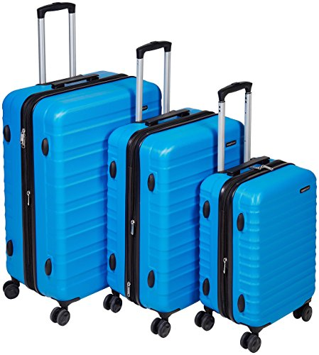 AmazonBasics - Set di trolley rigidi con rotelle girevoli, Set da 3 pezzi (55 cm, 68 cm, 78 cm), Blu chiaro