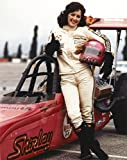 The Poster Corp Bonnie Bedelia Posed in Car Racing Outfit Carrying Her Helmet Photo Print (20,32 x 25,40 cm)