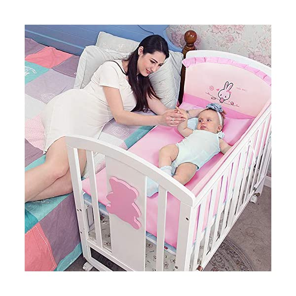 QINYUN Crib Solid Wood Multi-function Baby Cradle Bed Newborn Splicing Big Bed With Roller QINYUN 1. The crib is a safe, comfortable and easy to use bed that enhances the child's newly discovered independence. 2. Storage function - increase the storage space, convenient for the treasure mother to store the baby toy splicing storage board, and it is more convenient to change the table later. 3. It can give the baby enough security and let the baby enjoy a comfortable sleep. You don't have to worry about your baby's sleep quality anymore. 5