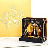 Biglietto d'auguri tridimensionale, elegante e dorato, con pop up a forma di palcoscenico teatrale