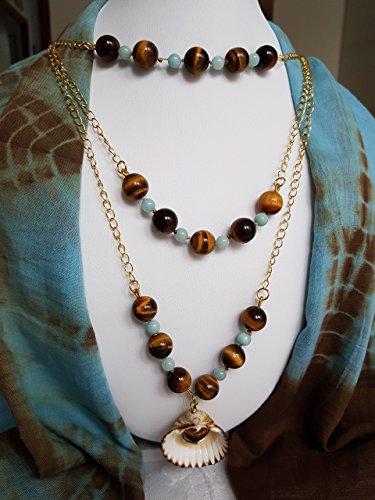 Conchiolina bijoux: collana lunga a tre livelli con occhi di tigre e amazzonite. ciondolo di conchiglia.