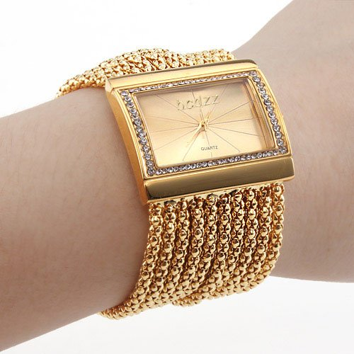 reloj-tipo-brazalete-con-diamantes-de-mujer-dorado