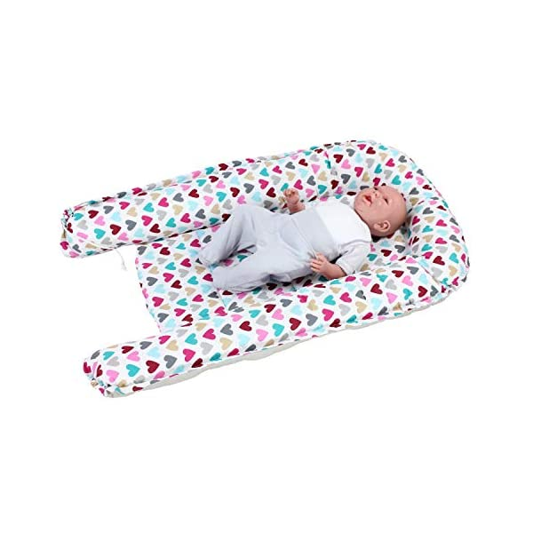TupTam Baby Sleep Nest Portable Cuddle Nest - 2-sided, Colorful Hearts/Gray, c. 85 x 55 cm TupTam Multifunctional baby sleep nest in beautiful colour combinations - the perfect companion for a newborn baby The cuddly soft, breathable 100% cotton outer fabric and the filling made of anti-allergic polyester fleece ensure an optimal sleeping climate Thanks to the soft underlay and stable sides, the baby feels secure and is protected against uncontrolled rolling 2