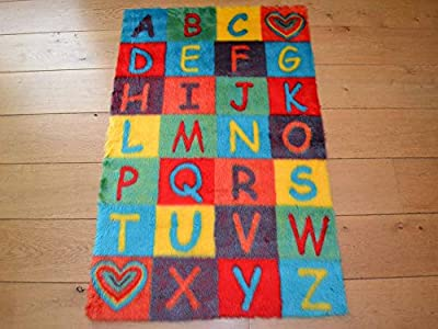 Alphabet ABC Non Slip Machine Washable Sheepskin Style Kids Rug. Size 70cm x 108cm produced by Rugs Supermarket - quick delivery from UK.
