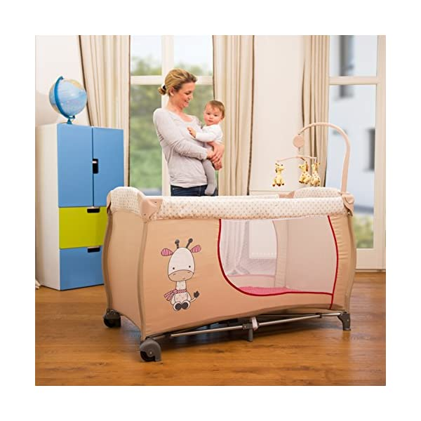 Hauck Baby Centre Travel Cot with Folding Mattress, Giraffe/Beige (Bassinet, Changing Top, Nappy Station and Cot Mobile) Hauck Distinctive travel cot complete with accessories. Age recommended: From birth to 9 kg Bassinet unit included to raise the sleeping position Includes clip on changing table 3