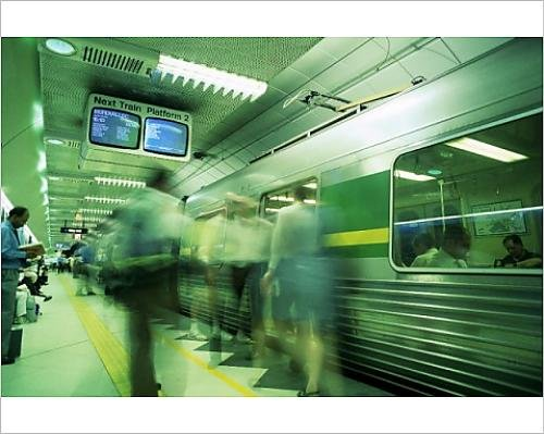 photographic-print-of-passengers-boarding-train-at-parliament-station-in-the-city-of-melbourne