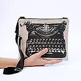 Borsa a tracolla Macchina da scrivere, tessuto bianco nero. Pratica borsa a tracolla con zip e manico regolabile.