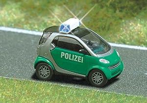 Busch - Juguete de modelismo ferroviario (Busch HO 5624 KFZ/SMART POLIZEI H0 blinkendes Automodell BUE5624)