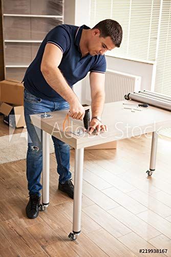 Wunschmotiv: Man uses tools to assembly furniture in new house.He will use this furniture for the interior of the new flat. #219938167 - Bild als Klebe-Folie - 3:2 - 60 x 40 cm / 40 x 60 cm - Stock Tool Assembly