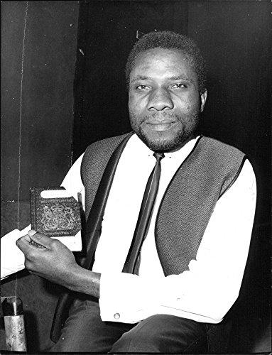 vintage-photo-of-joachim-hieronimus-mwingira-show-his-passport-from-before-the-tanzanian-liberation
