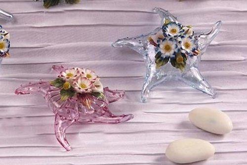 Idea bomboniere: stella marina in vetro soffiato rosa con decoro fiori in porcellana. misure 7x7cm