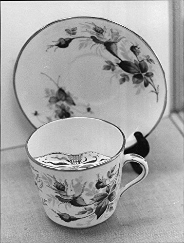 vintage-photo-of-a-mustache-cup-with-elegant-floral-motifs-that-are-usually-used-for-decoration-in-t