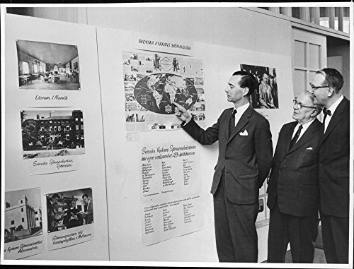 vintage-photo-of-the-reverend-robert-murray-considers-one-of-the-maps-in-the-exhibition-along-with-t