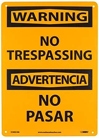 NO TRESPASSING NMC ESW81RB Bilingual OSHA Sign Legend WARNING 10 Length x 14 Height Rigid Plastic Black On Orange