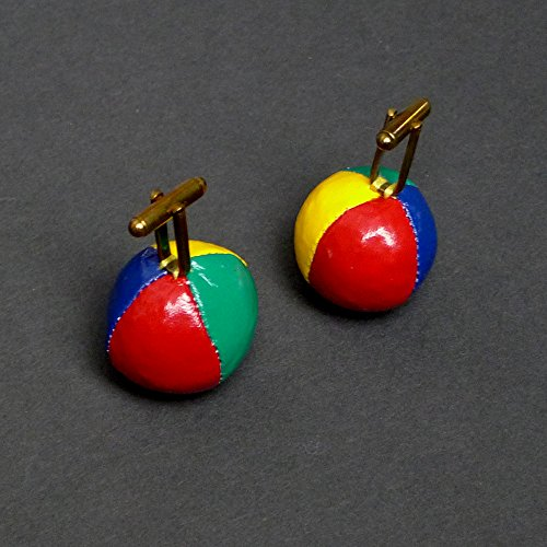 """paio di Gemelli da polso a forma di palle da jongler"