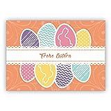 Klassisch schöne Osterkarte mit bunten Ostereiern und Osterhase: Frohe Ostern