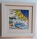 Quadro in ceramica con cornice in legno colore bianco 31 x 31 cm con mattonella 20 x 20 cm raffigurante lo scorcio di Capri i due faraglioni .