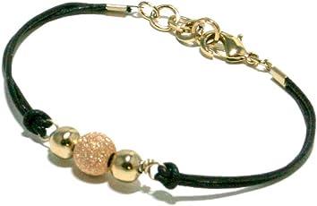 Bracciale cordino nero con centrale sfere in metallo colore oro e oro rosa.