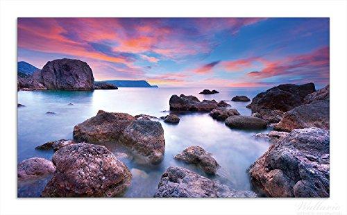 Wallario Herdabdeckplatte / Spritzschutz aus Glas, 1-teilig, 90x52cm, für Ceran- und Induktionsherde, Seelandschaft in blau und rot mit großen Felsen