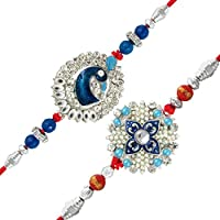 This combo of two peacock inspired rhodium plated rakhis will leave your brother stunned in delight. The rakhis come with a potli containing gulal/kumkum and rice. The gulal/ kumkum is free from any toxic chemicals and is completely organic. ...