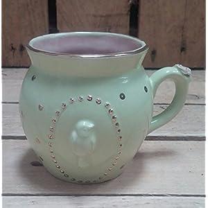 Keramik Tasse,mit Vogelrelief und Golddetails