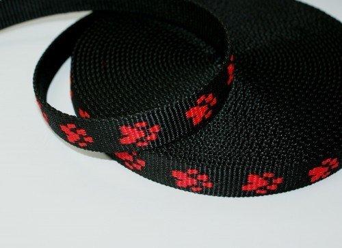 Produktbild 25mm breites Pfötchengurtband - rote Pfötchen auf schwarzem Gurtband - 1m Rolle