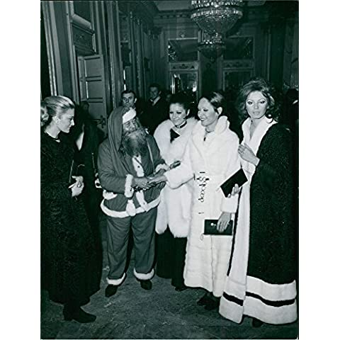 Vintage photo of For the first time in history, a Santa Claus was admitted into the sacred and holy interior of the Scala Opera House. He is pictured here with the beautiful models who represent the international Haute Couture. 1970.