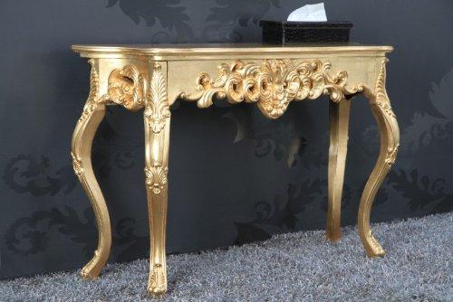 Mesa tocador estilo barroco color dorado. Detalles florales en patas y estructura.