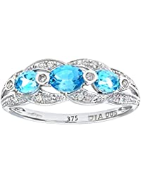 Revoni - 9ct White Gold Blue Topaz And Diamond Fig 8 Design Ring