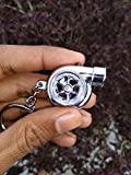 #9: KREEPO® Spinning Turbo Keychain Keyring Turbocharger Turbine Key Chain Ring Keyrings (Black), Car Decorations, Perfect Gift (Silver) For Toyota Etios Liva