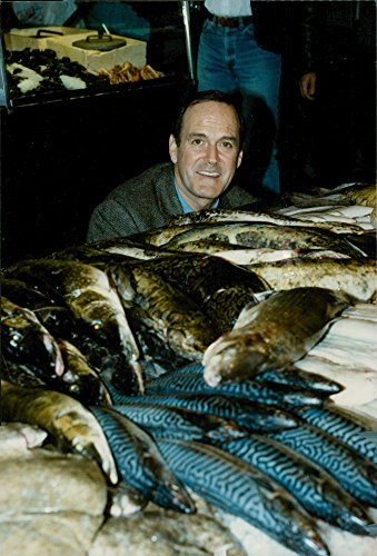 vintage-photo-of-john-cleese-hugs-fish-in-its-stockholm-walk-for-the-premiere-of-the-jam-packed-come