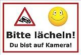 Video-Überwachung Schild - Bitte lächeln - Du bist auf Kamera – 15x10cm mit Bohrlöchern | stabile 3mm starke PVC Hartschaumplatte – S00348-016-B – Kamera-Überwachung +++ in 20 Varianten erhältlich