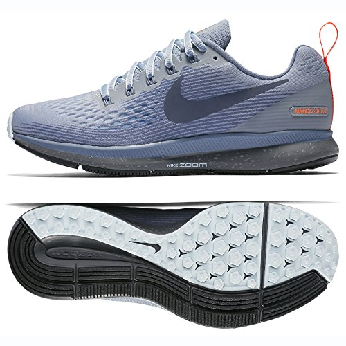 0f3febfffdc7f Nike W Air Zoom Pegasus 34 Shield, Zapatillas de Deporte para Mujer, (Wolf  Grey/Thunder Dark Sky Blue 002), 37.5 EU