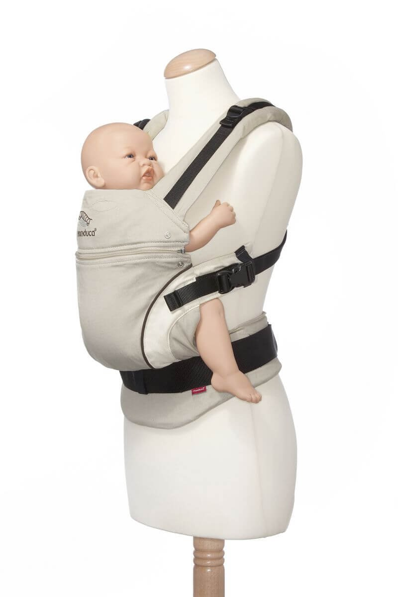 manduca First Baby Carrier > HempCotton Sand < Ergonomic Baby Carrier, Soft & Sturdy Canvas (Organic Cotton & Hemp), Front Carry, Hip Seat and Back Carry, from Newborn to Toddlers up to 20kg, Beige Manduca New features: Improved three-point-buckle (secure & easy to open); extra soft canvas made of 45% hemp and 55% organic cotton (outside), 100% organic cotton lining (inside) Already integrated in every baby carrier: infant pouch (newborn insert), stowable headrest & sun protection for your baby, patented back extension (grows with your child); Optional accessories for newborns: Size-It (seat reducer) and Zip-In Ellipse Ergonomic design for men & women: Soft padded shoulder straps (multiple adjustable) & anatomically shaped stable hipbelt (fits hips from 64cm to 140cm) ensure balanced weight distribution. No waist-belt extension needed 6