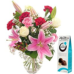 The Oriental Charm Bouquet with Free Chocolates is a delight to behold. Featuring a combination of exotic oriental lilies with roses and carnations, this exquisitely colourful arrangement is perfect as a gift for a loved one or to decorate yo...