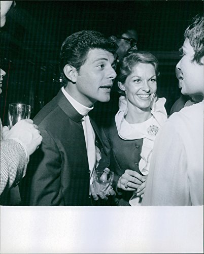 vintage-photo-of-frankie-avalon-with-wife-kathryn-diebel-talking-to-someone1968