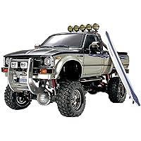 Tamiya 300058397 Toyota Hilux Hi Lift - Vehículo radiocontrol todoterreno (escala 1:10,
