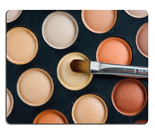 MSD Mousepad Image ID 24348642 Makeup brushes and eyeshadow palette in beige orange tones cosmetics close up