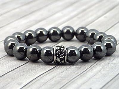 Bracelet pour homme Thurcolas gamme Stone Power en hématite avec perle à tête de mort en acier inoxydable