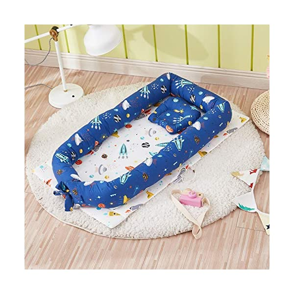 TEALP Multifunctional Baby Nest Navy Blue Galaxy Outer Space, Baby Bassinet for Bed/Lounger/Nest/Pod/Cot Bed/Sleeping, Breathable & Hypoallergenic Cotton (0-24 Months) TEALP 【Breathable and Hypoallergenic Cotton】hypoallergenic materials, breathable and non-toxic. We use 100-percent cotton fabric and breathable, hypoallergenic internal filler, which is safe for baby's sensitive skin. It will give your child serene, safe, and sound sleep in their lovely co sleeping crib. 【Adjustable Design】1 baby nest, 90x55x15cm;1 pillow30x30cm, Suitable for 0-24 Month. GROWS WITH YOUR BABY. Being adjustable, the side sleeper grows with your baby. Simply loosen the cord at the end of the bumpers to make the size larger. The ends of the bumpers can be fully opened. 【Multifunctional and Portable】 Use the infant nest as a bassinet for a bed, baby lounger pillow, travel bed, newborn pillow, changing station or move it around the house for lounging or tummy time, making baby feel more secure and cozy. 2