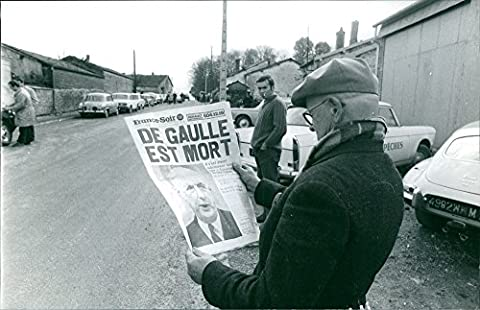 Reprint image of Man reading news about Charles de Gaulle, dead.