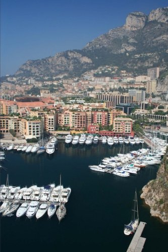 luxury-yachts-in-the-harbor-and-view-of-monte-carlo-monaco-journal