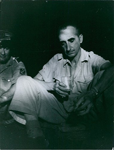 vintage-photo-of-general-christian-de-castries-sitting-and-drinking
