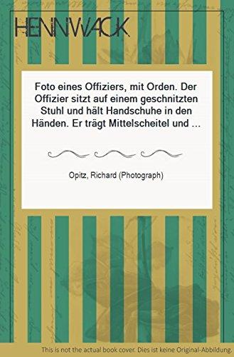 (Foto eines Offiziers, mit Orden. Der Offizier sitzt auf einem geschnitzten Stuhl und hält Handschuhe in den Händen. Er trägt Mittelscheitel und Schnurrbart. Unten gezeichnet: Richard Opitz, Potsdam.)