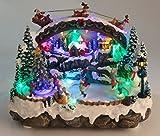 Weihnachtsstadt mit Licht Musik und Eisläufern